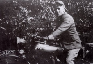 T E Lawrence (1888-1935) on his motorbike
